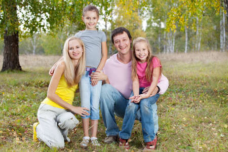 Happy family with children in autumn park Stock Photo - 12472135
