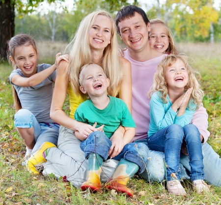 large: Happy large family with children in autumn park Stock Photo