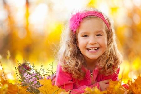 Happy little child in autumn park photo
