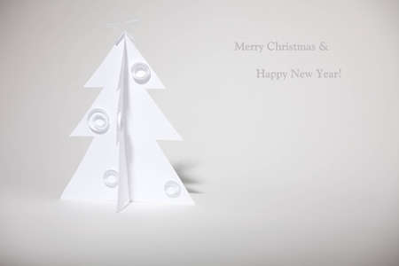 Christmas tree made ??of paper. Christmas card. Stock Photo - 12784054