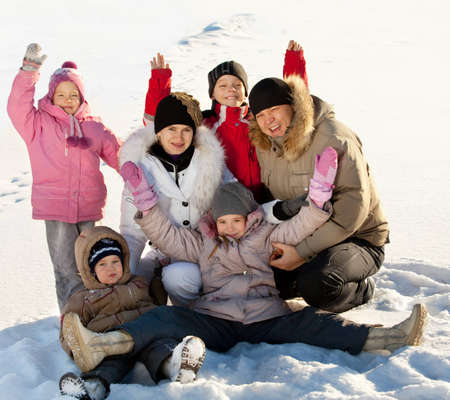 large family portrait: Family with children in the snow in winter.