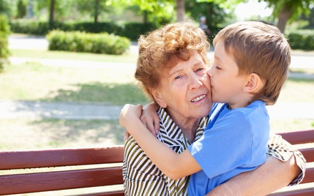 grandchild: Grandmother with grandchild. Old woman with grandson