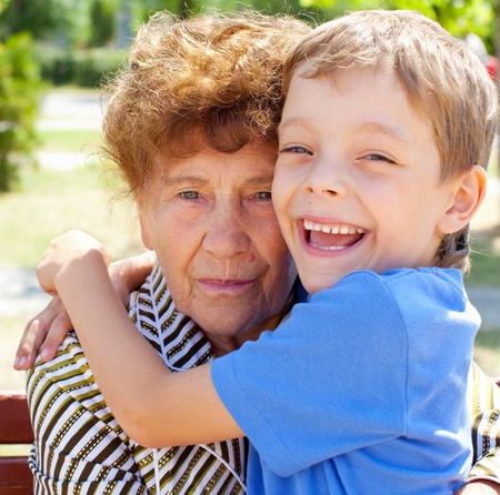 grandmother and grandson: Grandmother with grandchild. Old woman with grandson
