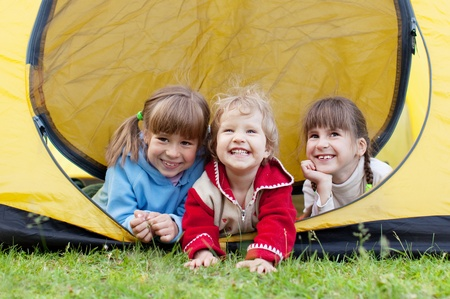 Happy children in tent. Family outdoors photo
