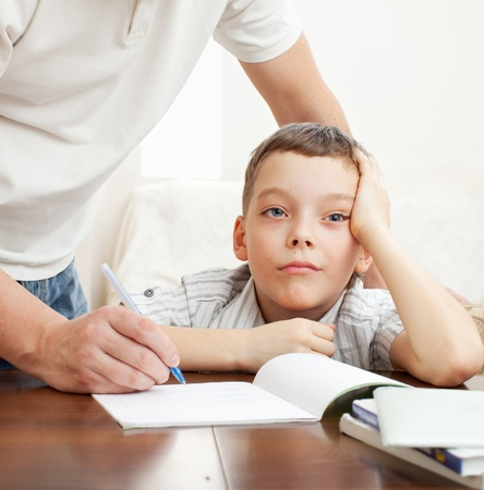Father helping son do homework. Problems with homework photo