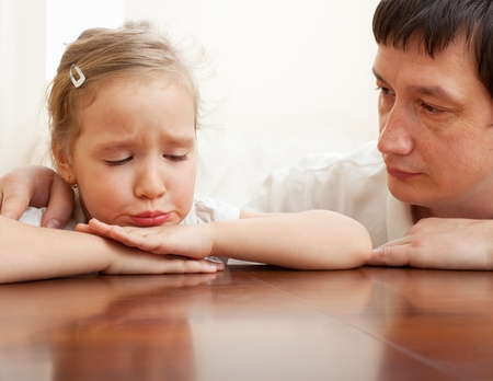 grievance: Father comforts a sad child. Problems in the family