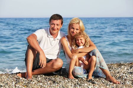 Family on beach. Mother, father and child on beach. photo