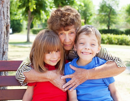 grandmother grandchild: Grandmother with grandchild. Old woman with children Stock Photo
