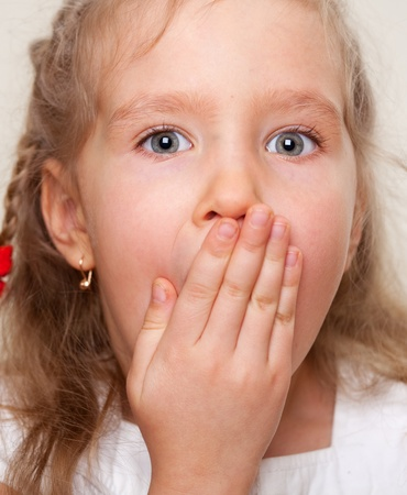expression facial: Surprised little girl with open mouth. Portrait clouseup. Stock Photo