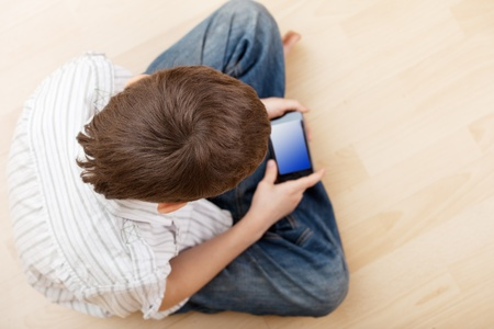 topdown: Child with smart phone. Boy play smart phon Stock Photo