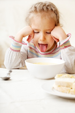 only child: Child looks with disgust for food.  Stock Photo