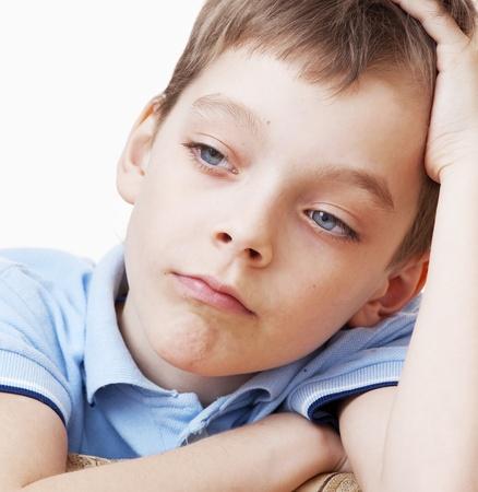 Sad boy. Depression child at home photo