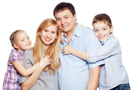 Happy family with two children isolated on white background. Parents with daughter and son studio shot photo