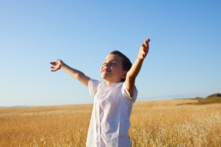 Child outstretched against the sky photo