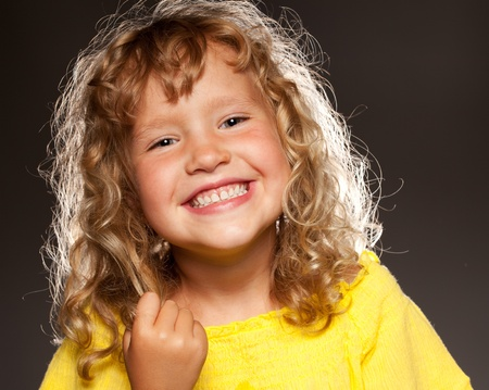toothy smile: Happy child on black background