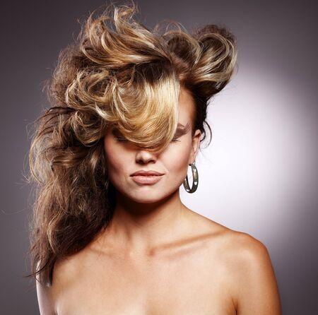 Beautiful woman with stylish hairstyle photo