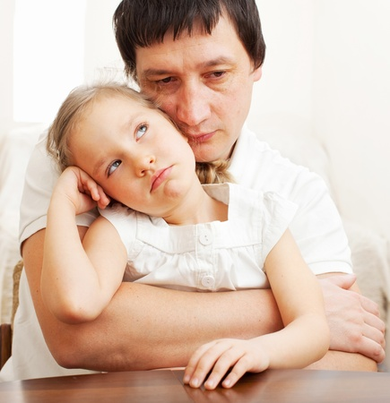 Father comforts a sad girl. Problems in the family Stock Photo - 13084796