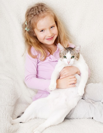 only girls: Girl with cat. Child with pet at home