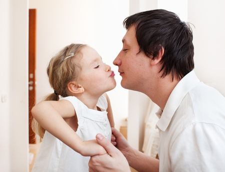 Daughter kissing her dad. Happy family Stock Photo