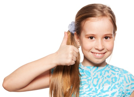 Happy girl showing thumb up. Happiness child showing sign okay Stock Photo