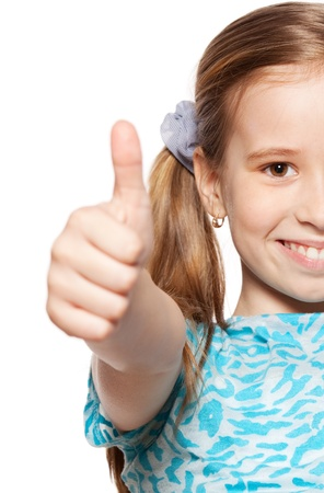 front teeth: Happy girl showing thumb up. Happiness child showing sign okay Stock Photo