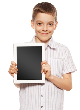 �hild with a tablet pc. Boy playing on tablet isolated on white background photo