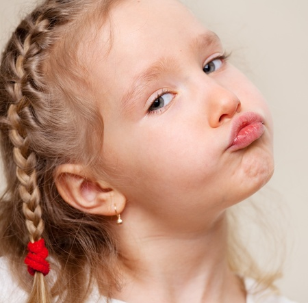 Grimacing child. Capricious little girl. Stock Photo - 13473329