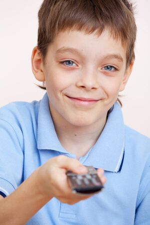 Child with remote control. Happy boy with remote photo