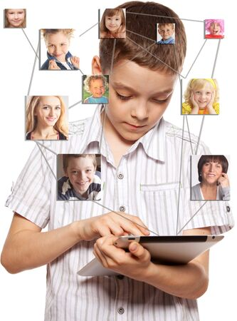 Kids in social network. Child looks to the tablet computer. Social group photo