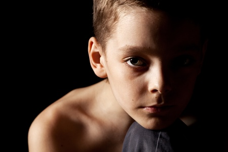 Sad boy on black background. Portrait depression teenager. stress photo