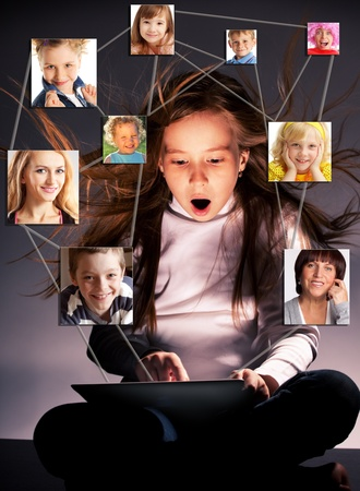 surprised child: Kids in social network. Child looks to the tablet computer. Social group Stock Photo