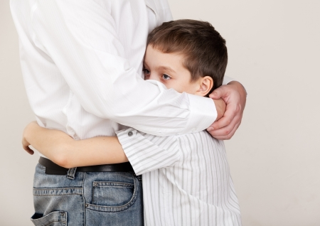 Father comforts a sad child. Problems in the family. Pain Stock Photo