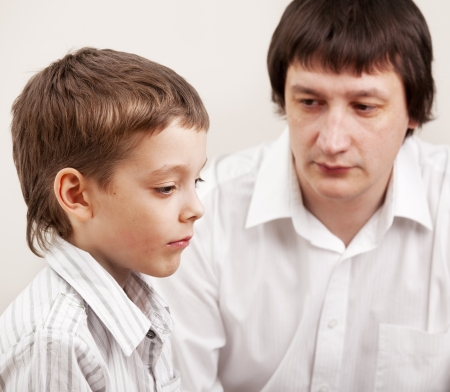 consoling: Serious discussion between father and son. Problems in family. Conflict dad and child Stock Photo