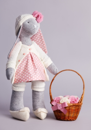 Soft toy on gray bakground photo