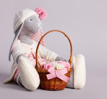 Soft toy on gray bakground. Handmade photo