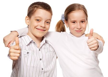 Happy children showing OK isolated on white background. Kids show thumbs up photo
