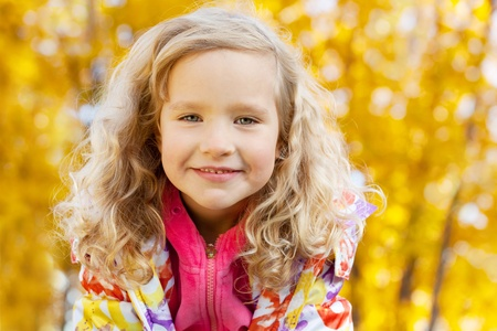 only girls: Happy kid in autumn park Stock Photo