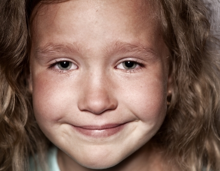 Crying child. Sad little girl portrait closeup photo