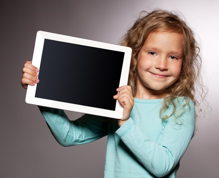 Happy child with tablet computer. Kid showing  photo