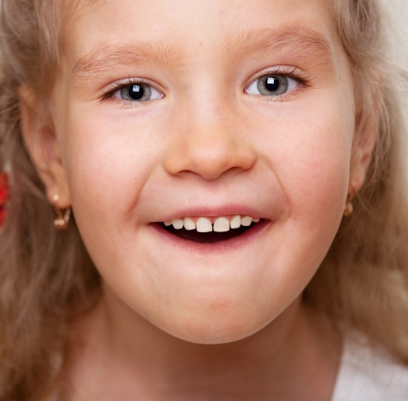 girl open mouth: Surprised little girl with open mouth. Portrait clouseup. Stock Photo