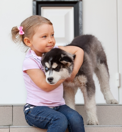 Child with a dog on the porch photo