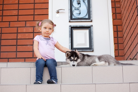 Child with a dog on the porch Stock Photo - 14202850