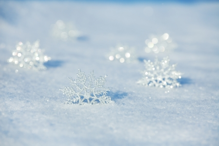december: Winter background. Snowflakes on snow Stock Photo