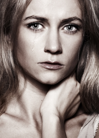 Sad woman with tears in her eyes photo