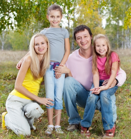 Happy family with children in autumn park Stock Photo - 14754949