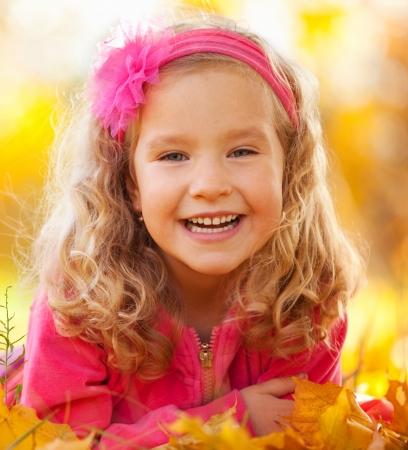 children laughing: Happy little child in autumn park Stock Photo