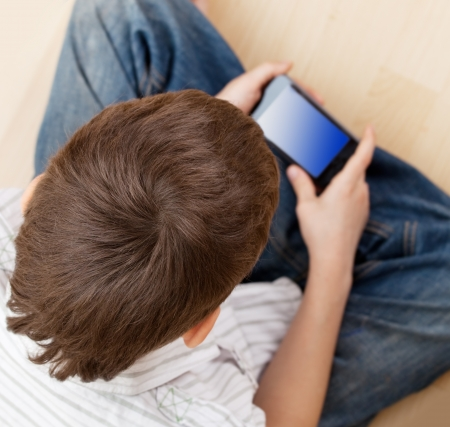 phon: Child with smart phone. Boy play smart phon Stock Photo