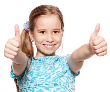alright: Happy girl showing thumb up. Happiness child showing sign okay Stock Photo