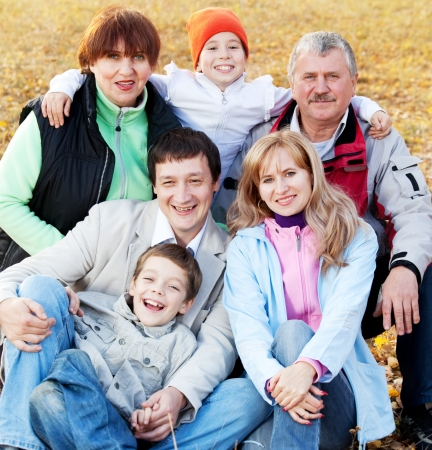 big smile: Big family in autumn park. Mother, father, grandmother, grandfather and children outdoors