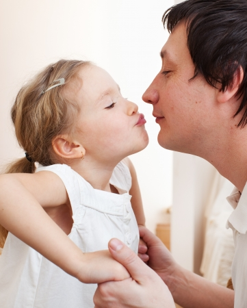 men 45 years: Daughter kissing her dad. Happy family Stock Photo